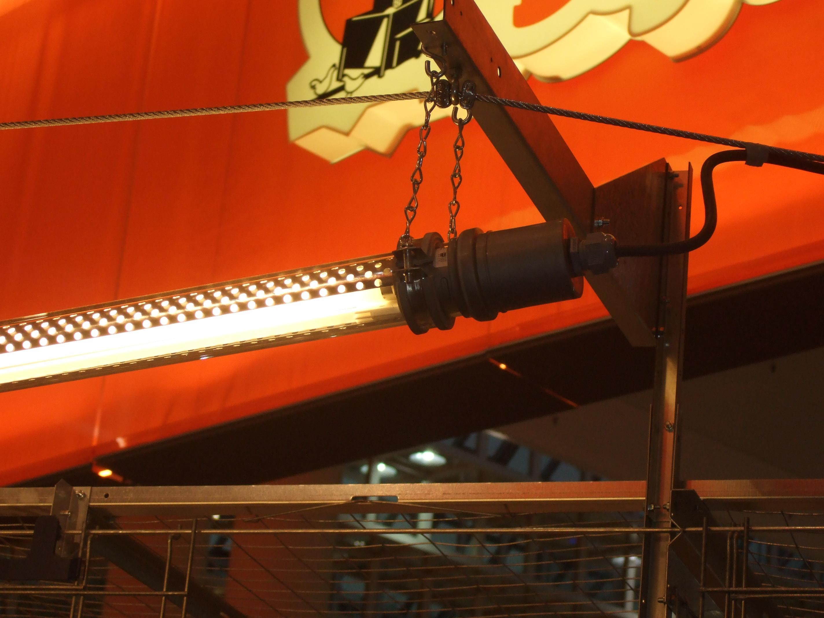 Светильник с перфорированной шторкой.
